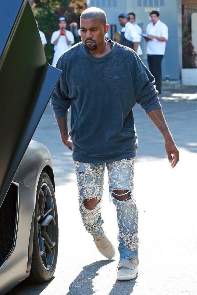 Kanye West Wearing Yeezy Boost 750 And Balmain Custom