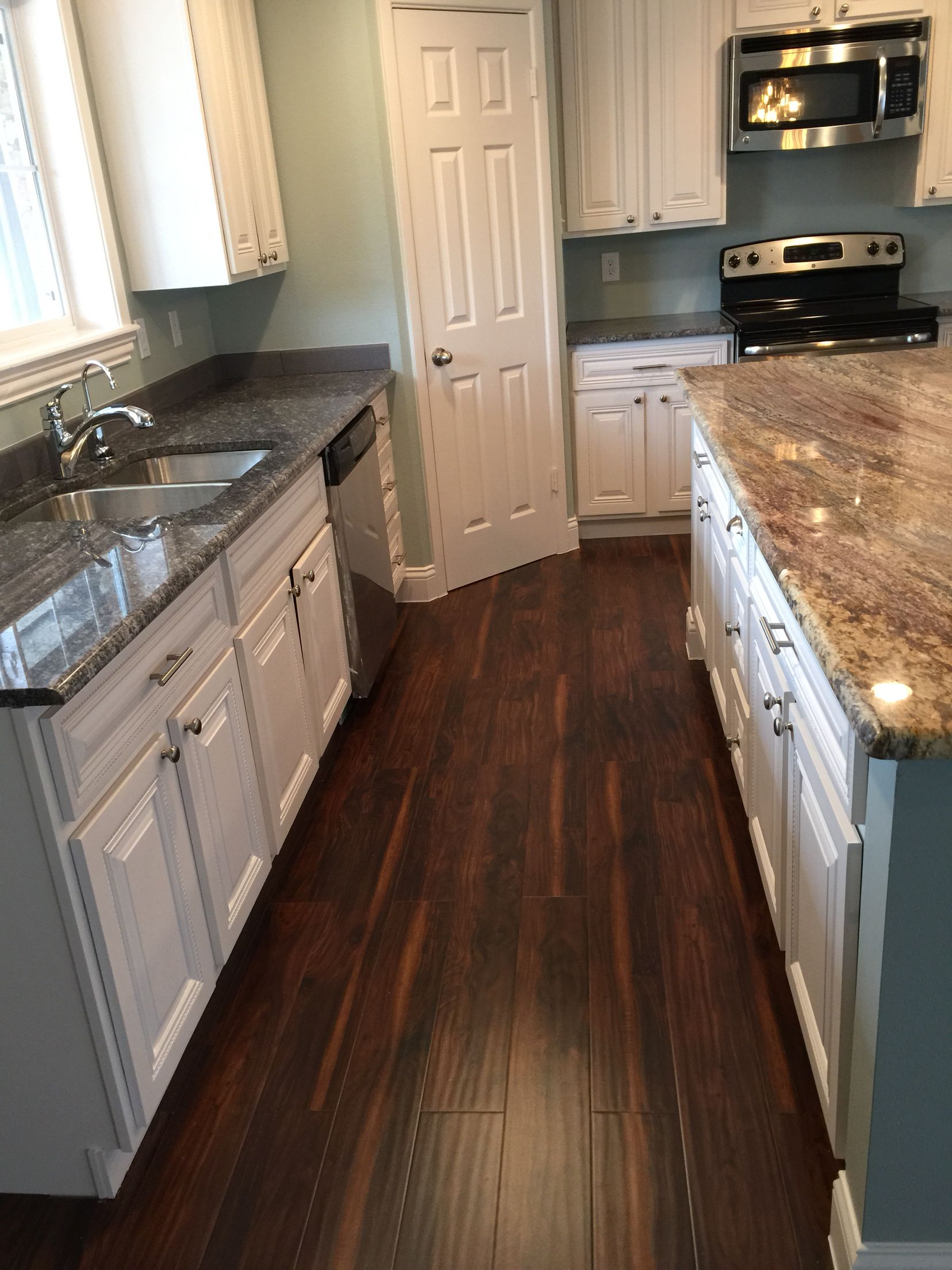 White Kitchen With Acacia Wood Floors Blue Ice Granite