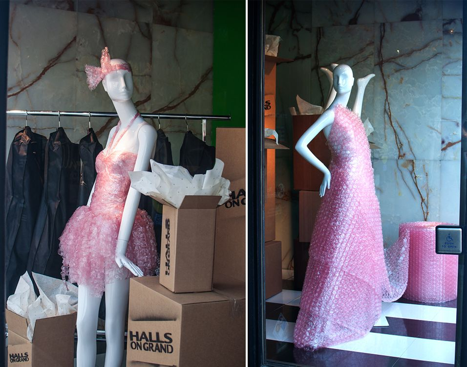 Moving window for Halls Kansas City. Adorable with branded moving boxes & mannequins dressed in bubble wrap. #merchandising #windowdisplay