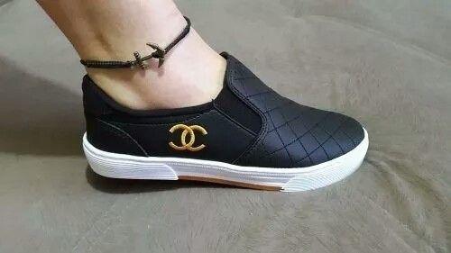 1dd10f8c29 Chanel preto com dourado  519