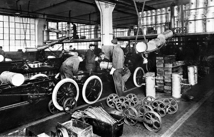 Henry Ford S Moving Automotive Assembly Line Turns 1 Ford Henry Ford Model T Assembly Line