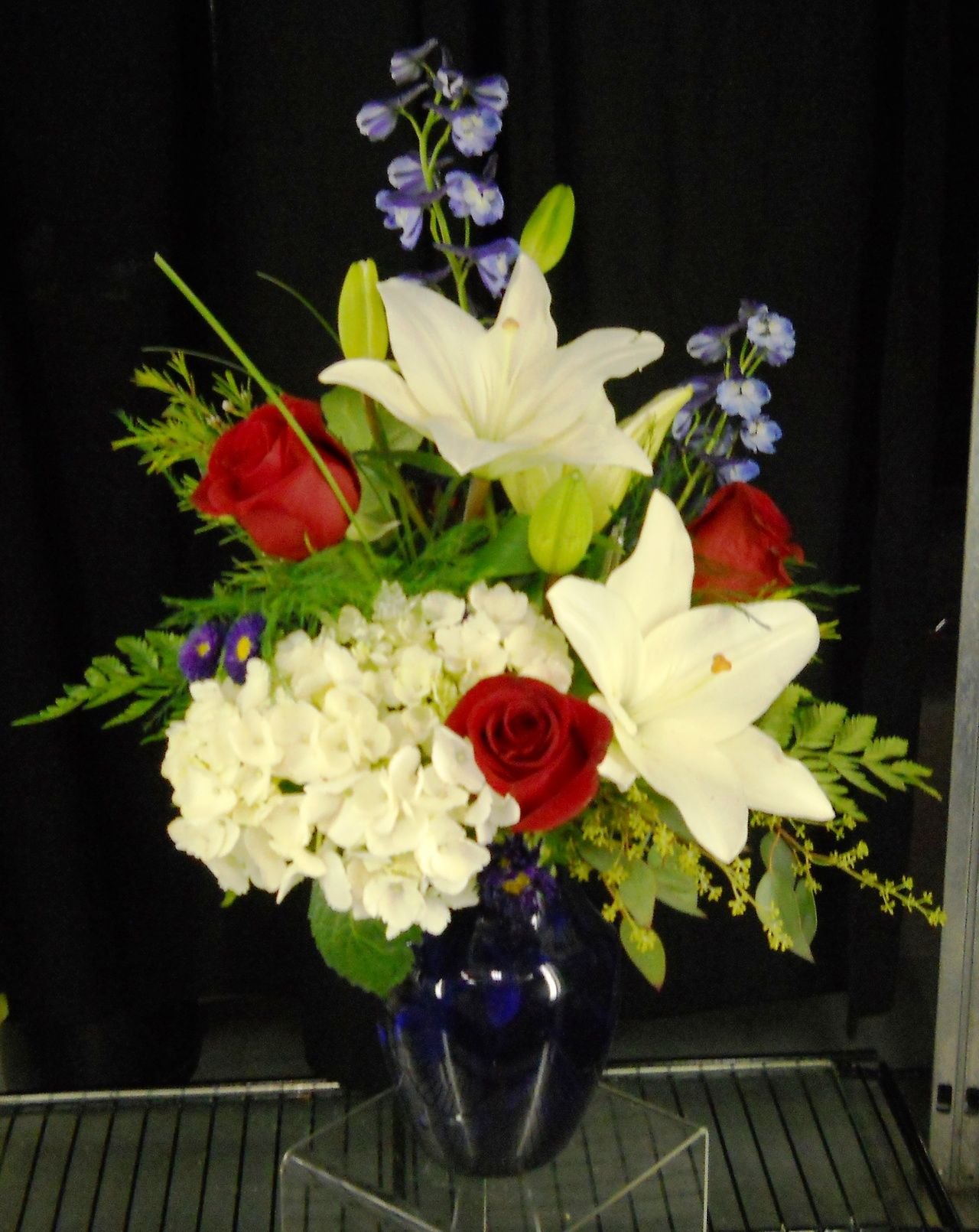 Fourth of july arrangement with white lilies and red roses in blue fourth of july arrangement with white lilies and red roses in blue vase g johnsons floral images mightylinksfo