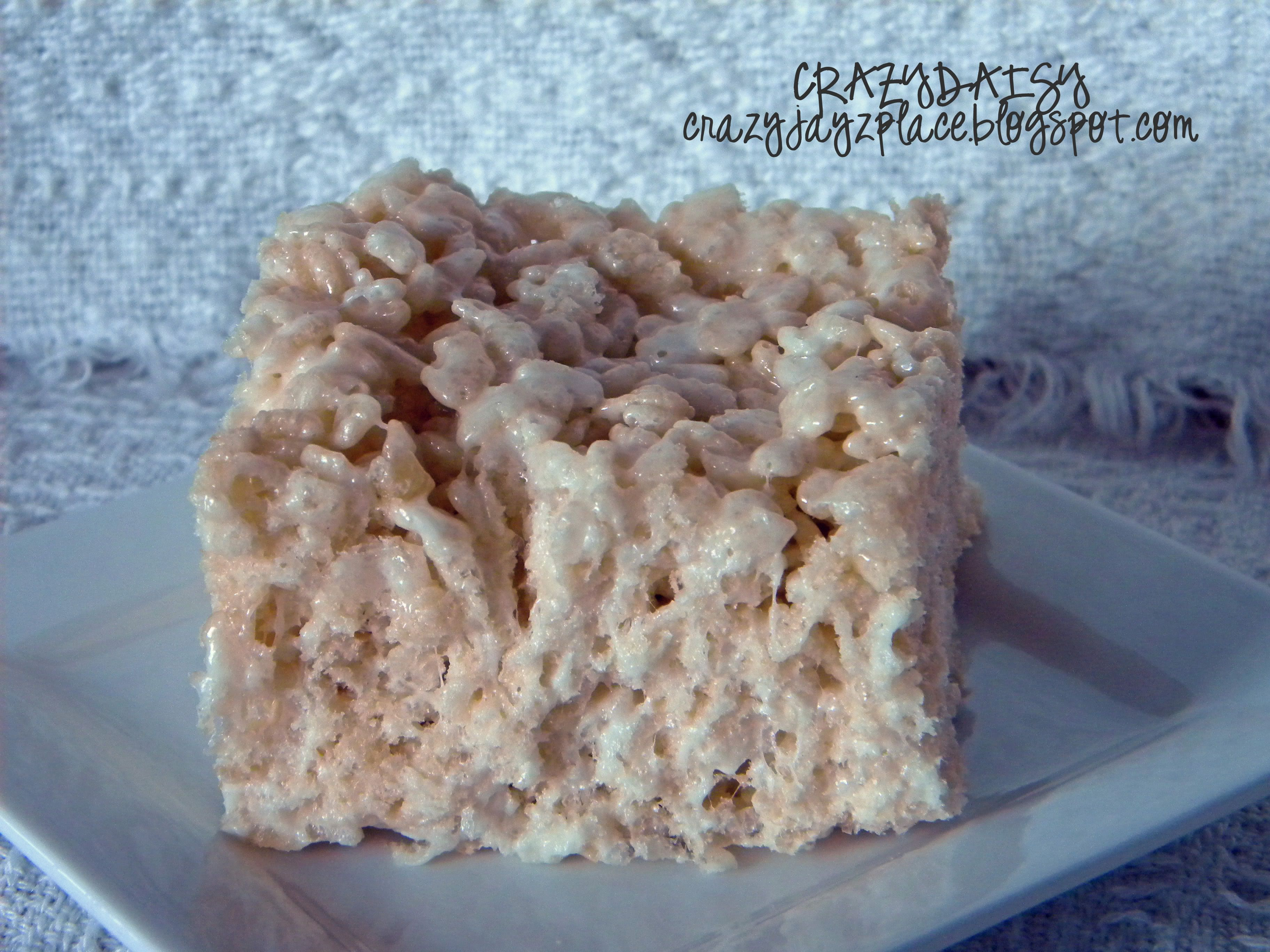 Ultimate Rice Krispie Treats - YEA! Ooey gooey marshmallow deliciousness. The ratio of butter, rice krispies, and marshmallow makes all the difference.