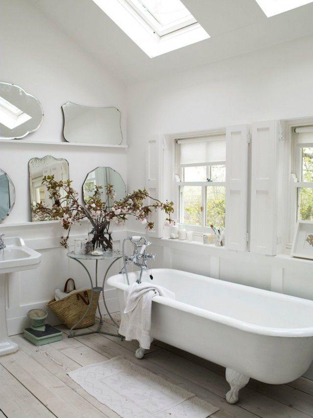 pretty rustic bathroom with roll top claw foot bath