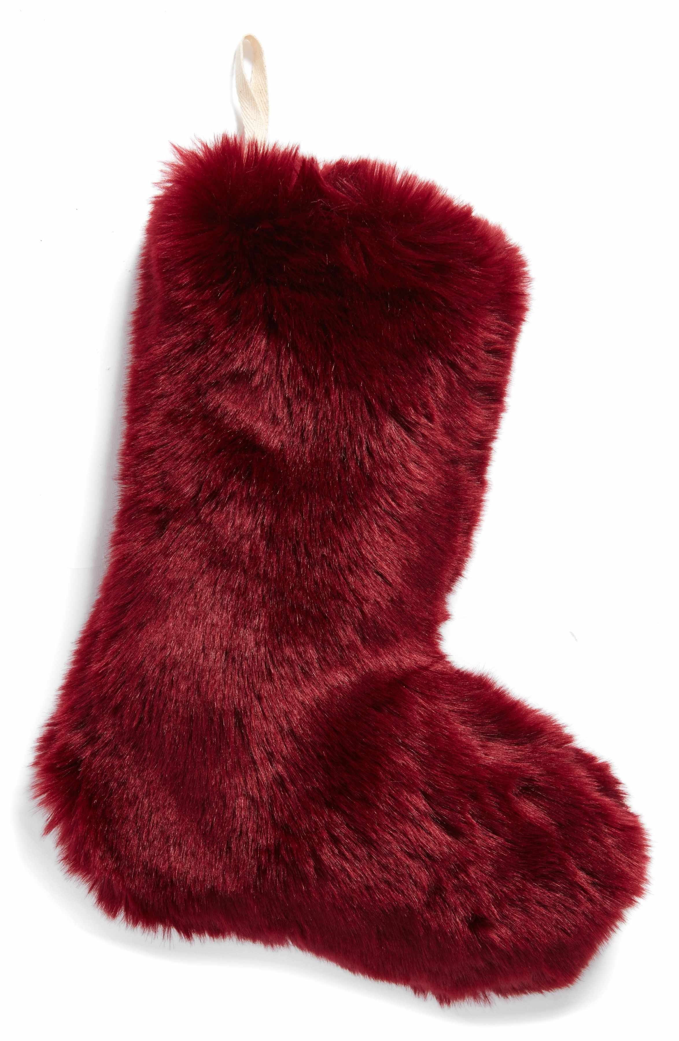 A plush Christmas stocking made from remarkably soft faux fur adds a ...