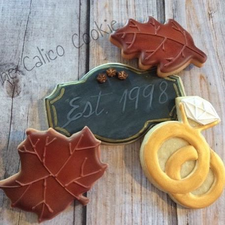 Special request for fall theme anniversary cookies with a chalk board plaque. #thecalicocookie #customcookies #edibleart #anniversarycookies
