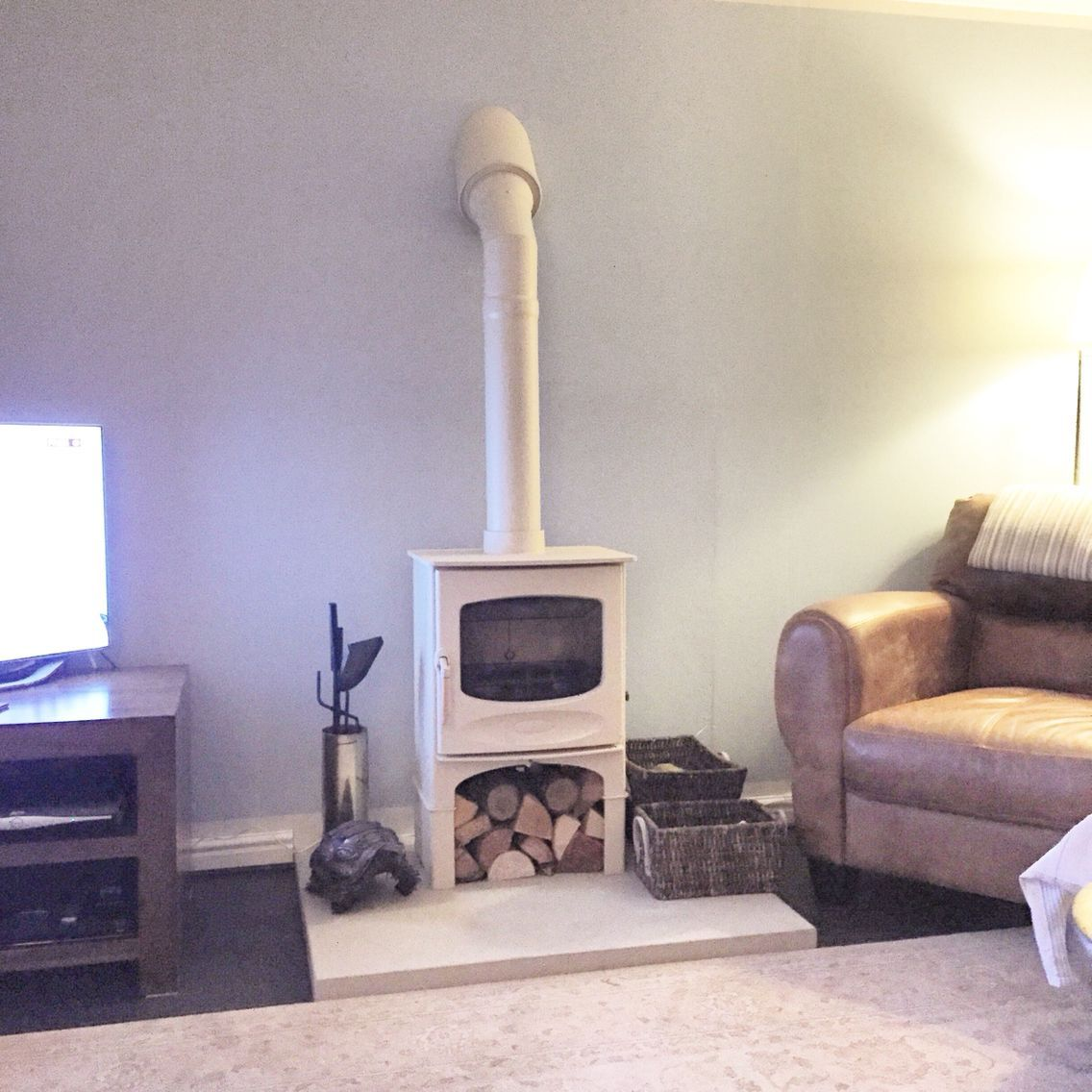 Stove With Log Store In Almond With Twin Wall Flue System Sandstone Hearth Almond Flue Freestanding Fireplace Corner Wood Stove Log Burner Living Room