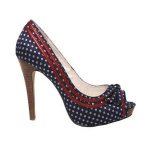 Love the red detailing on these adorable navy and white polka dot heels.