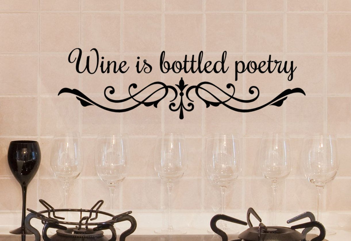 Wine Decor Words for Walls Wine is Bottled Poetry, vinyl wall art sticker,  bar sign decals. $21.00, via Etsy.