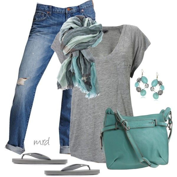 Laid-back boyfriend jeans paired with a thin, gray knit tee look sharp with muted turquoise accessories.