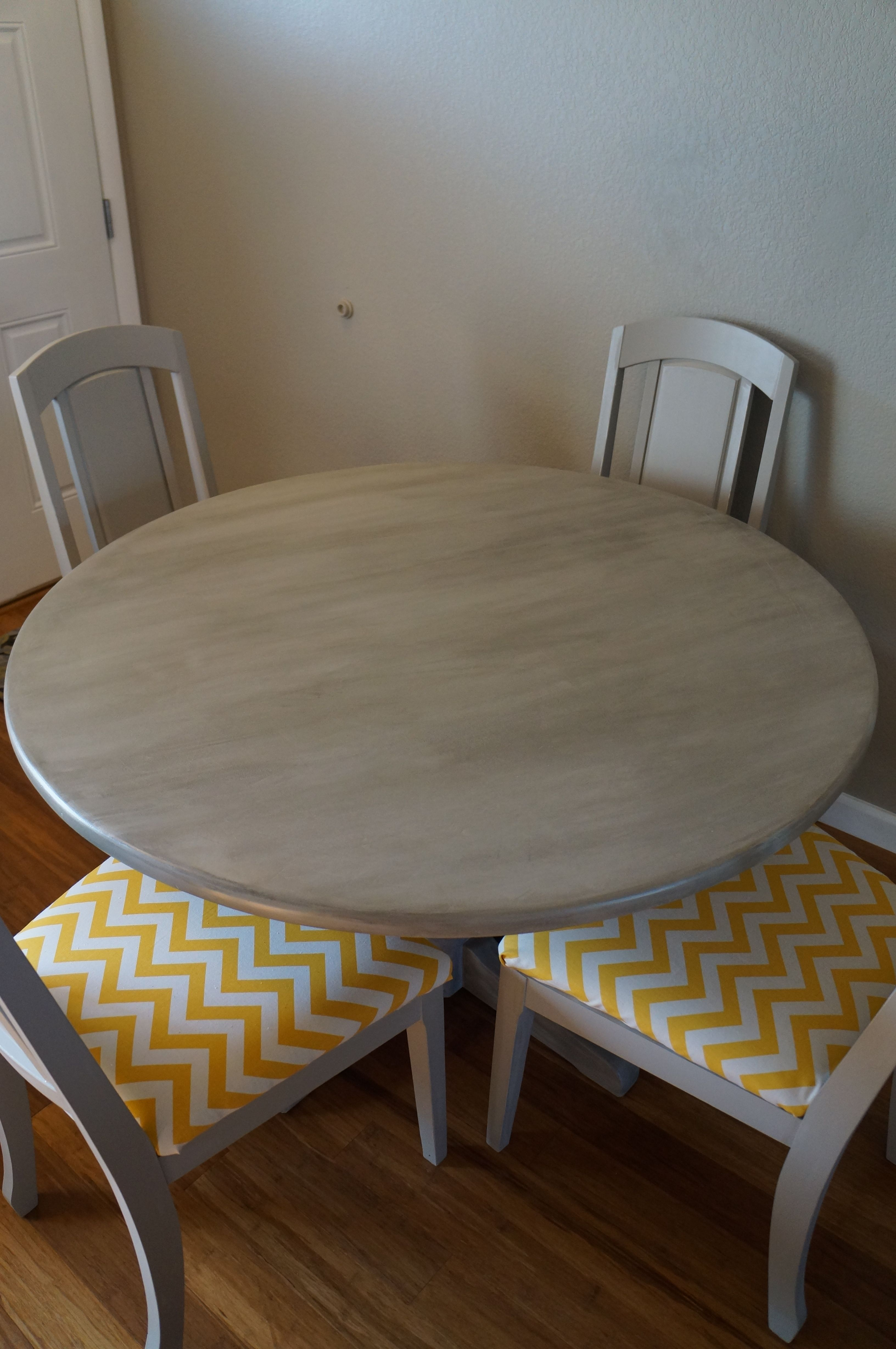Antiqued grey table with yellow chevron fabric kitchen tables