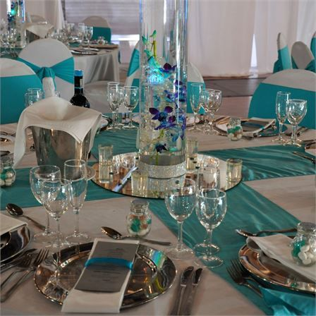 Stacey dale39s real wedding vibrant decor themed for Teal wedding theme ideas