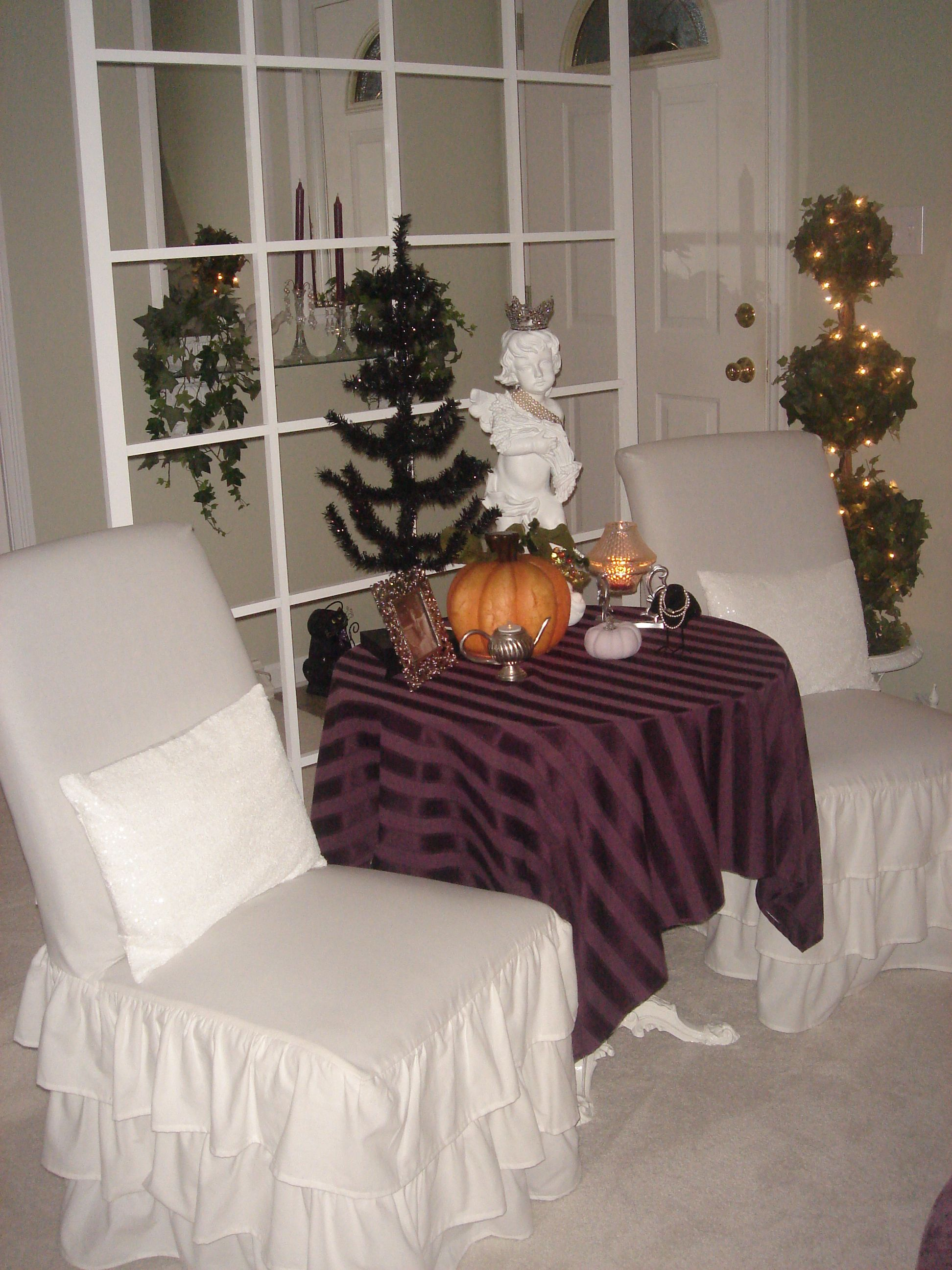 Shabby chic white chairs with room divider window decorated for - halloween window decor
