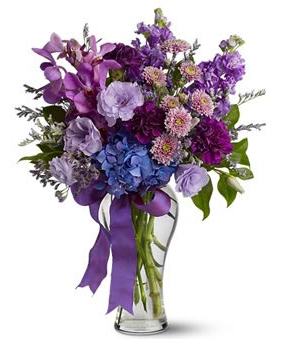 Beautiful valentines day arrangement with purple flowers