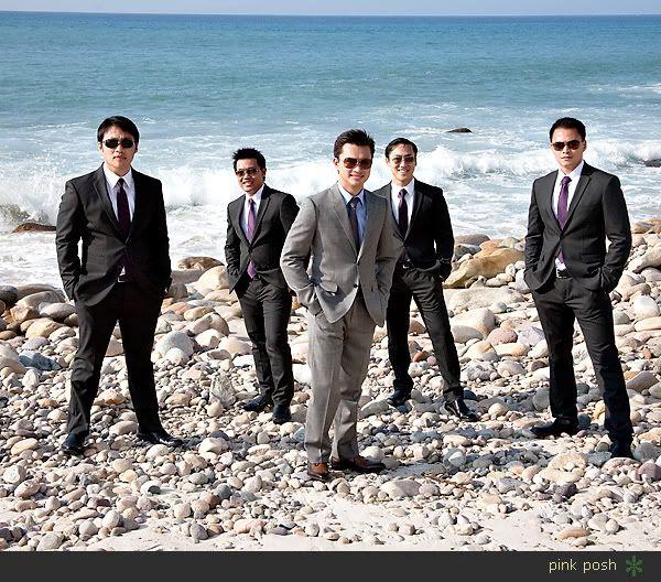 groom in lighter grey, groomsmen in darker grey.