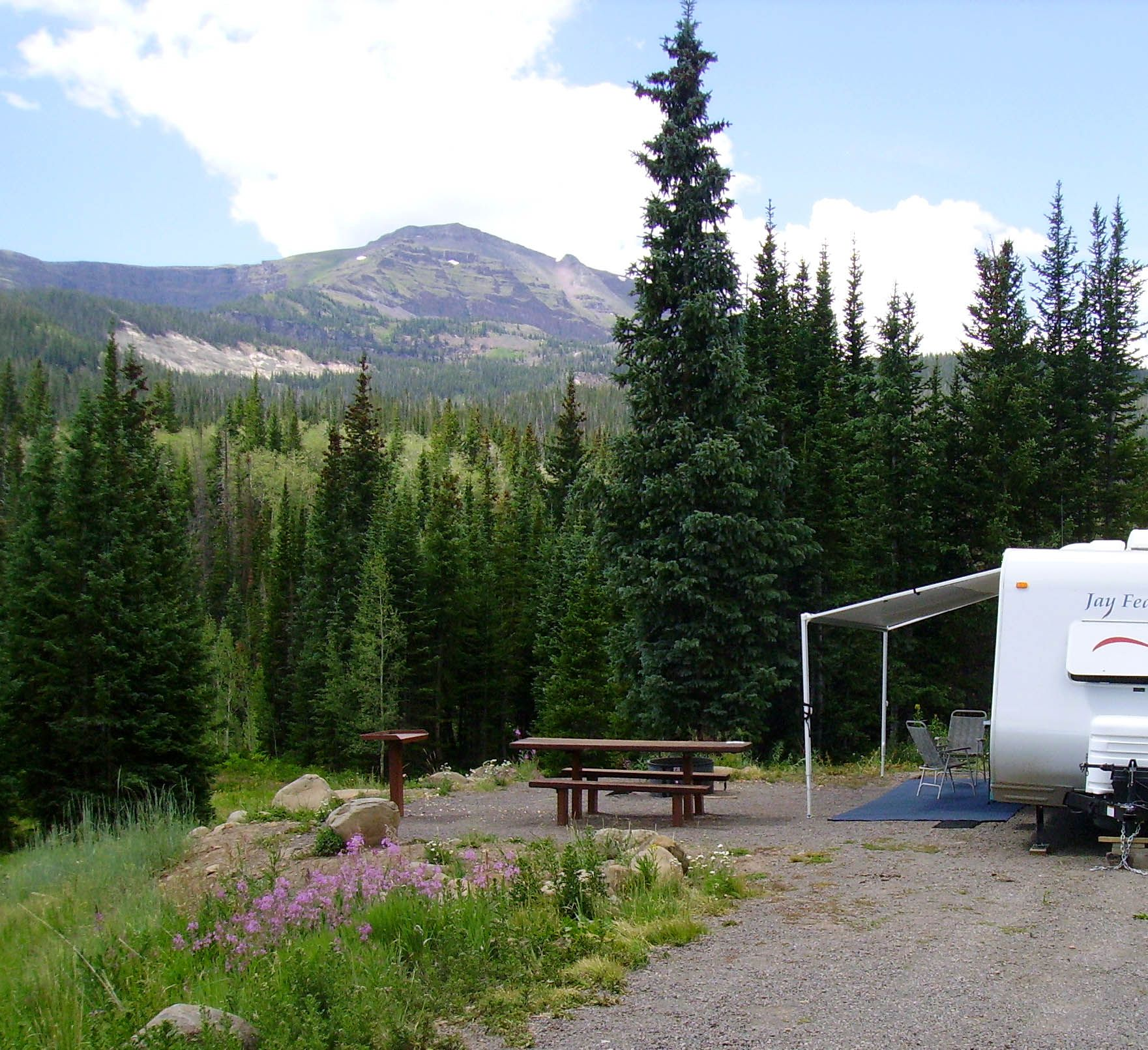 Photo of camper and Flat Top Mountain from Bear Lake