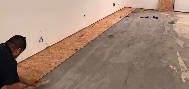 Basement Subfloor Options Dricore Versus Plywood Basement Subfloor Plywood Subfloor Concrete Floors Diy