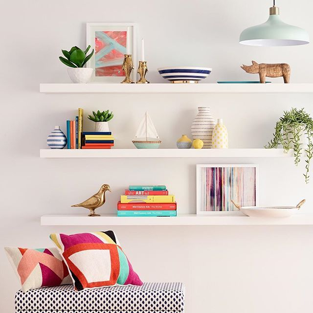 With Just A Few Add Ons Like Colorful Striped Bowls And Vases Animal Figurines And Fresh Plants Your Whit Colorful Shelf Home Decor Office Space Inspiration