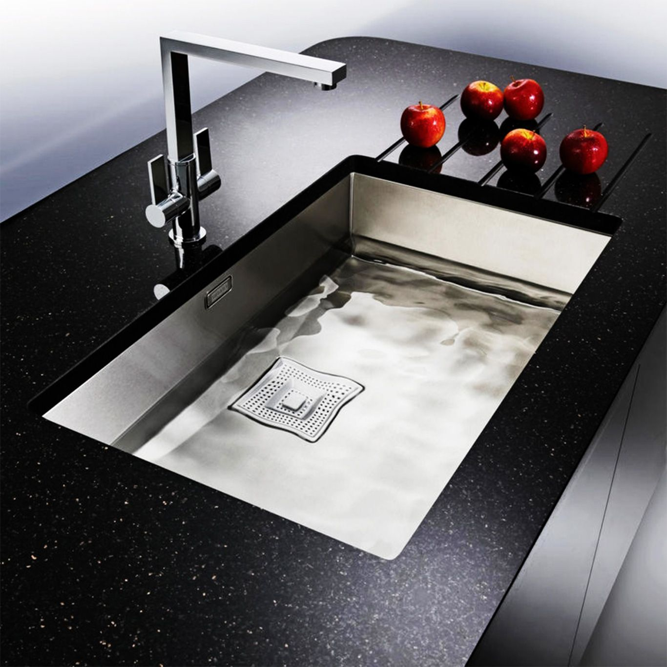 Awesome Modern Dark Countertop And Stylish Undermount Stainless Steel Kitchen Sink  On Long Counter Near White Wall