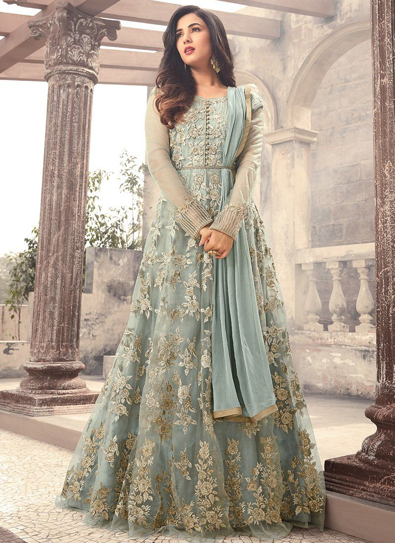 1d620a7462d Light Blue Embroidered Net Anarkali Suit features a beautiful net top  alongside a santoon bottom and inner. A chiffon dupatta completes the look.
