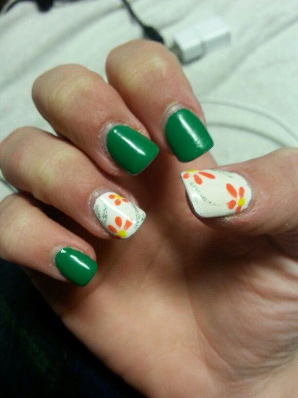 Green acrylic nails with orange flowers