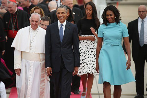 ... U.S. President Barack Obama, daughters Sasha and Malia, and first lady Michelle Obama arrive to greet the Pope September 22, 2015 at Joint Base Andrews, Maryland.