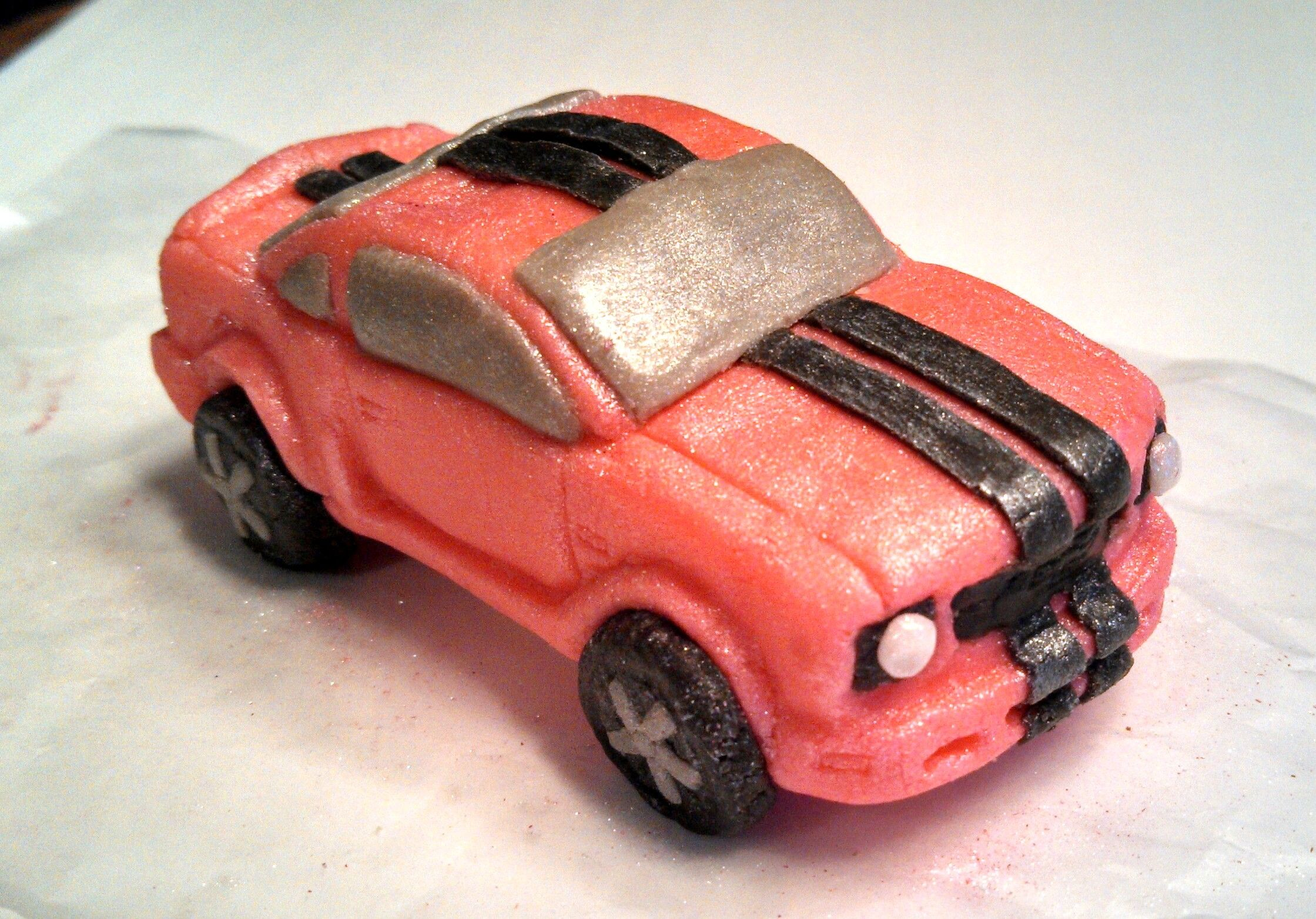 "Hot pink Mustang, carved out of candy clay for an upcoming ""Sweet 16"" cake! All edible!  https://www.facebook.com/angelas.cakes2011"