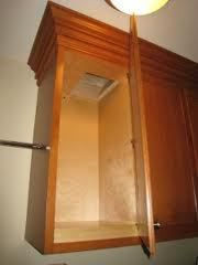 clothes chute concealed in a cabinet...brilliant!