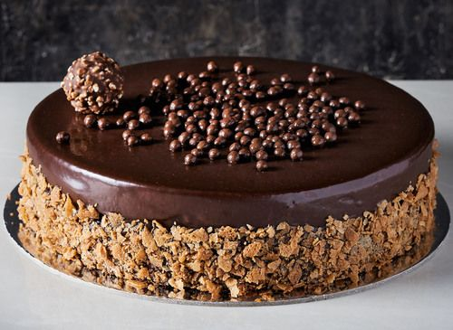 $9 Delivery Anywhere In Sydney. Looma's Ferrero Rocher Cake - just like eating the real chocolate.