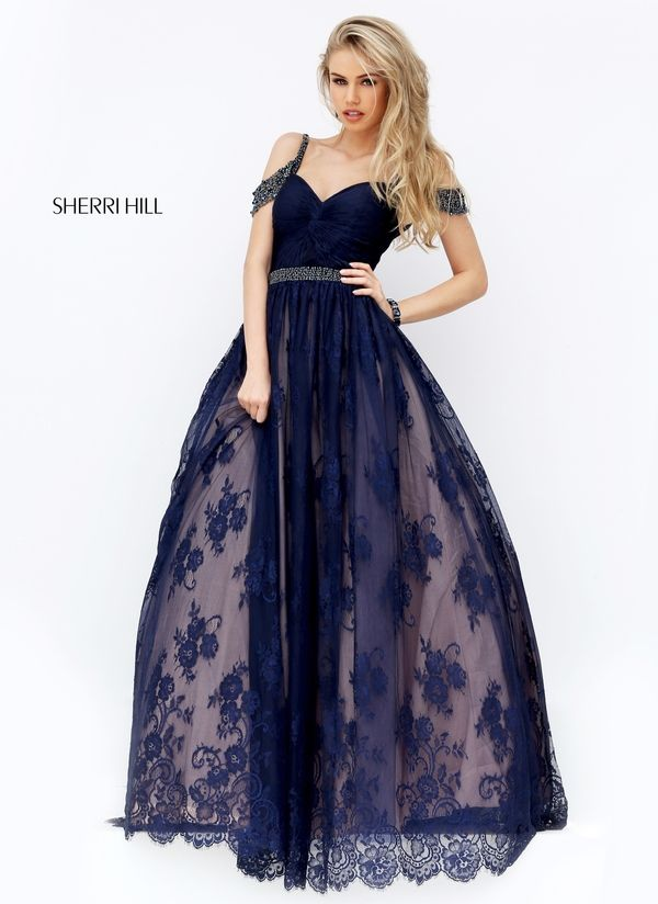 Elegant never goes out of style! #sherrihill #long #lace #navy #homecoming #hoco #prom