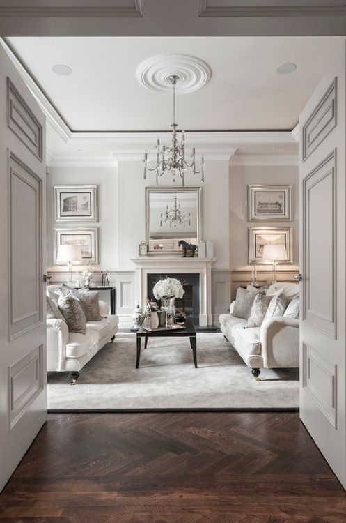 Soft grey formal living room with dark herringbone stained wood ...