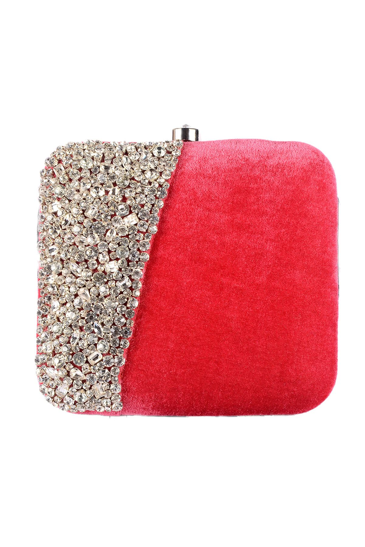 Shine bright with this sturdy box clutch crafted out of plush velvet fabric and sprinkled with beautiful rhinestone studs. Dipped in hues of vibrant pink, this bag adds the perfect amount of bling to your chic fashion statement. Pair this with a strapless knee length dress and high heels.