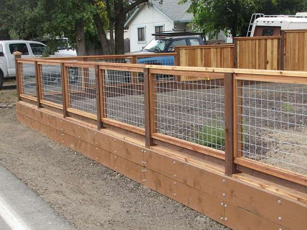 wood and hog wire fence … | Cheap chicken coop ideas | Pinterest ...