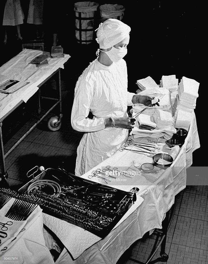 A Nurse Preparing The Sterile Equipment That Will Be Needed In An Vintage Nurse Nurse Photos Medical Photos