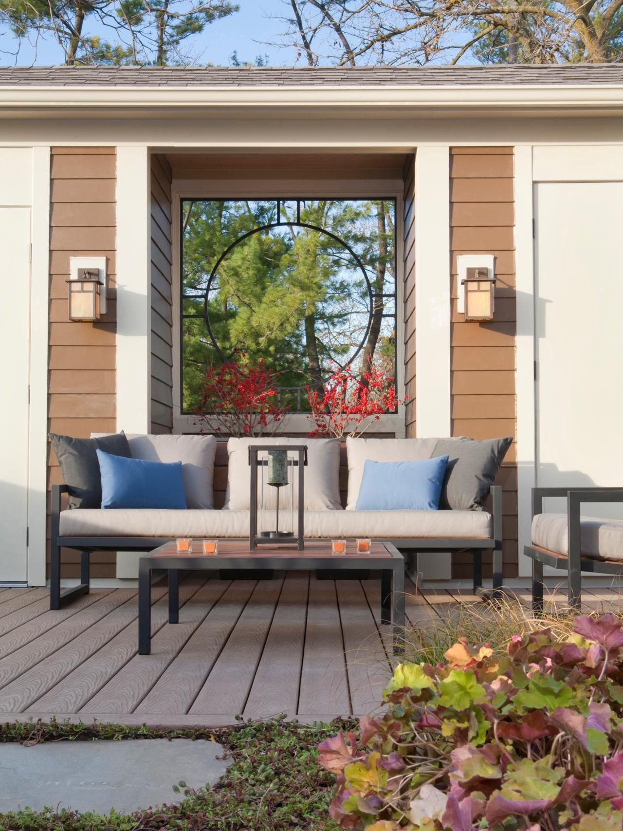 Home garden furniture  Sleek outdoor furniture creates a welcoming seating area on this