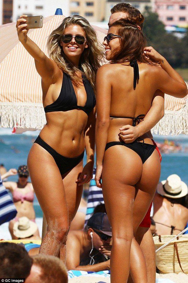 Something is. Australian bikini beach