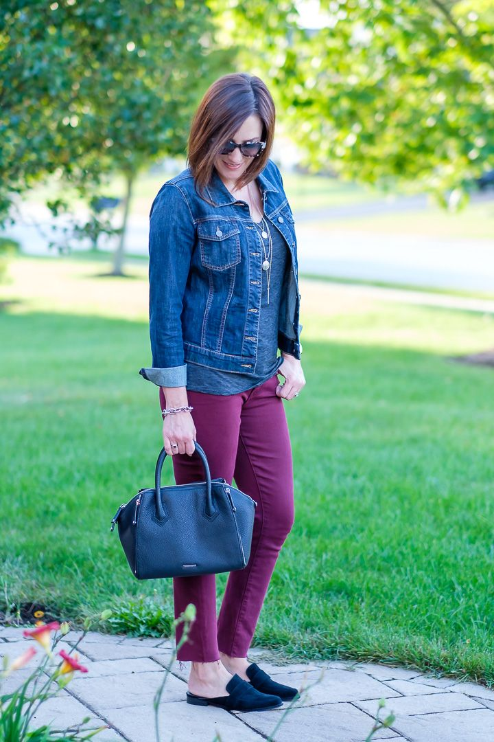 73ebbeaefd Jo-Lynne Shane styling burgundy jeans with a denim jacket and slide loafers