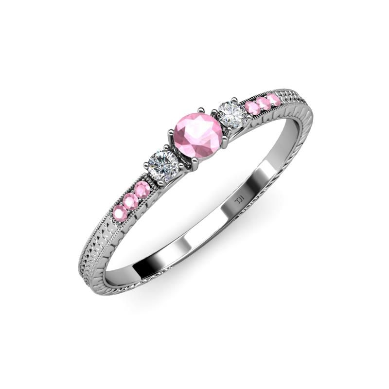 Delight the one you love with this elegant Three Stone Engagement Ring. Masterfully Crafted with Center Pink Tourmaline and Side Diamond. Additional Pink Tourmaline on the Side Bar make this Ring the most treasured item. While intricate Engrave detailing completes this Stunning Three Stone Ring. #love #finejewelry #pink #tourmalinering #weddingring