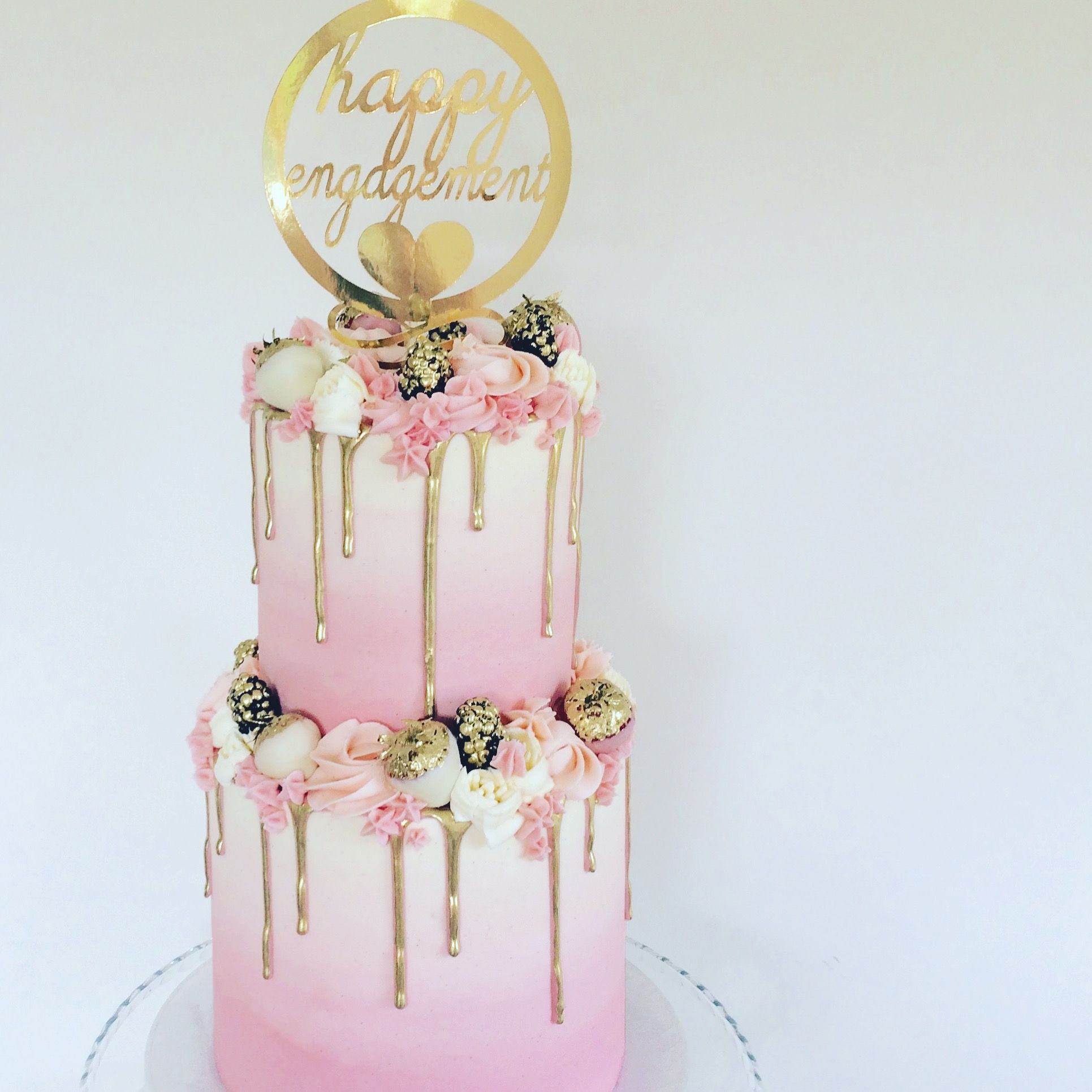 Two Tier Pink And Gold Cake With Gilded Fruits And A Gold Drip