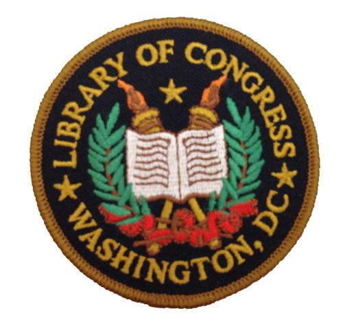 """The Library of Congress official patch features embroidered books and the torch of knowledge. 2.5"""" circumference"""