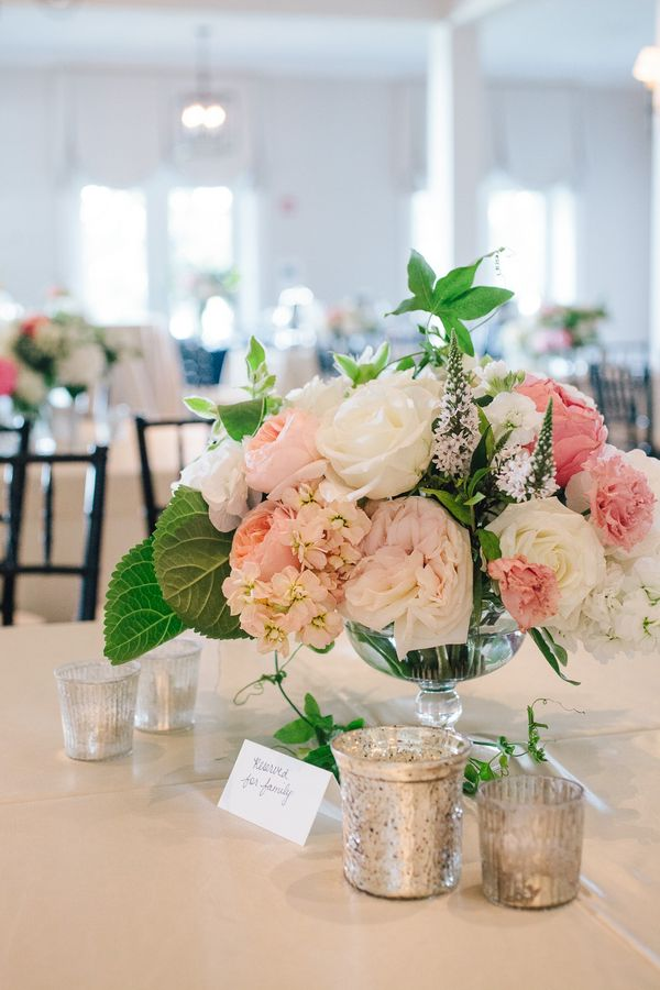 Whimsical blush pink centerpiece with peonies, roses, and ...