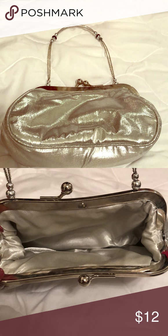 ffe6511b49e Little clutch Silky silver little clutch, in very good condition Bags  Clutches   Wristlets