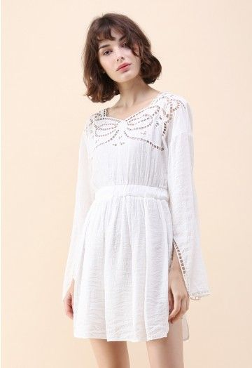 Give 'em butterflies when you float into the room wearing this white crepe dress with the embroidered design in the shape of the pretty winged creature. - Butterfly pattern eyelet - Cami underdress accompanied  - Elastic waistband - Split hem and cuffs - Keyhole cutout with button to reverse - Not lined - 65% polyester,35% cotton - Hand wash cold Size(cm)Length Bust Waist Shoulder Sleeves S/M        85   112  68-80   40      63 Size(inch)Length Bust Waist S...