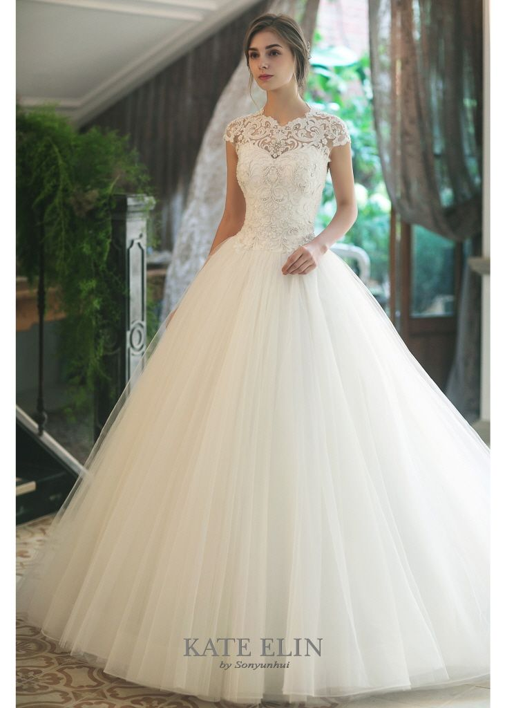 9e853b2ac578 Ivory bell line dress. Bodice with illusion round neck with silver  embroidery…
