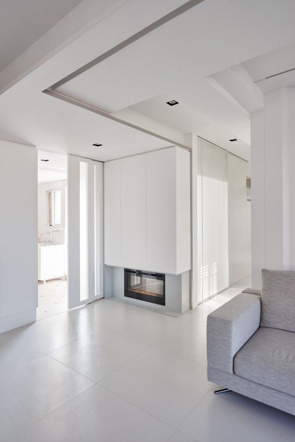 Awesome white walls and in floor storage make this creative house design special check more