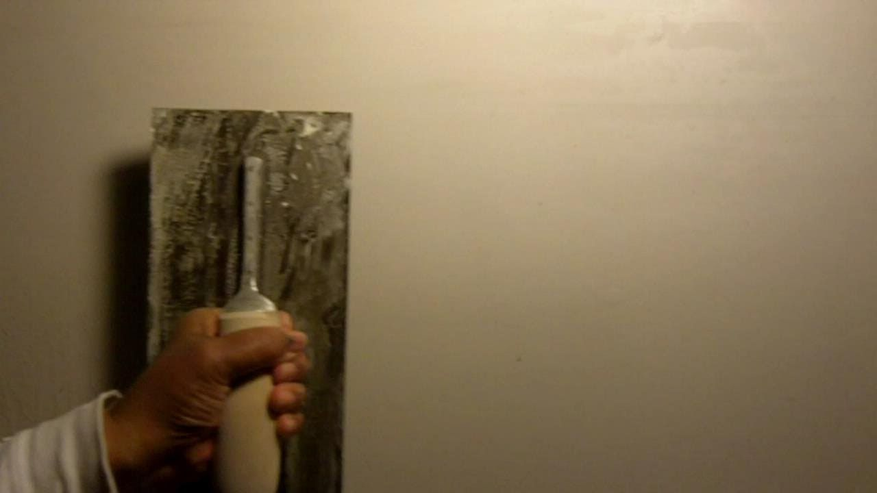 how to smooth out uneven plaster with a skim coat diy