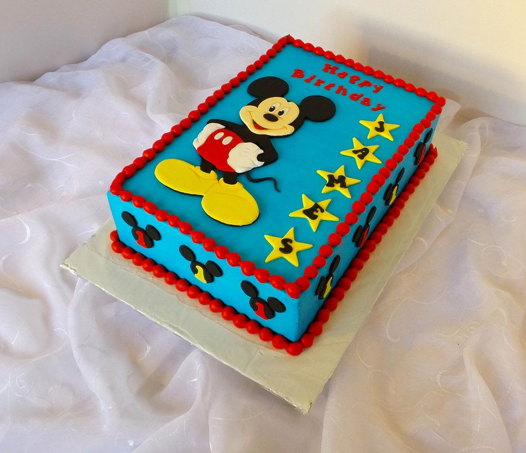 Mickey Mouse themed sheet birthday cake with hand cut fondant topper