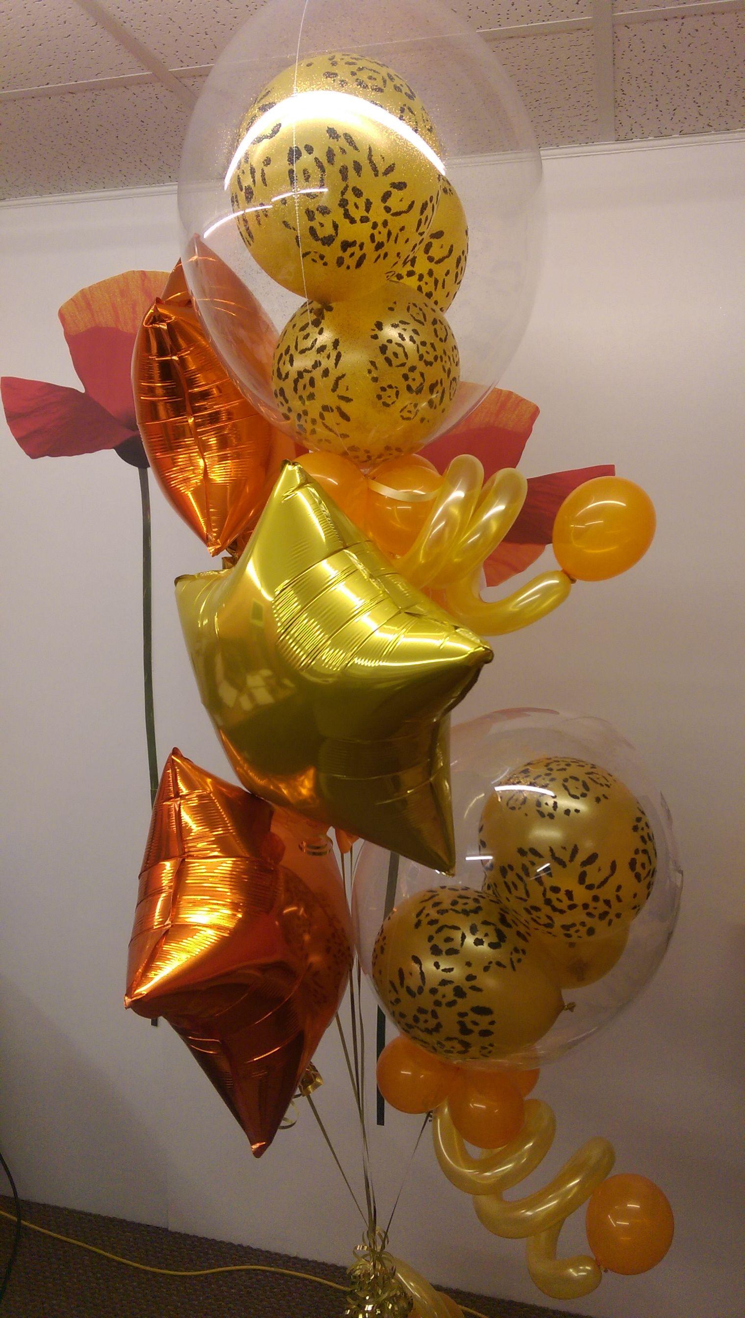 gold animal print inside balloons gold stars orange stars