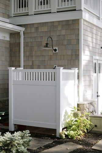 "Technically this is an outdoor shower, but what I see is ""what a cute fence to hide my ugly row of garbage cans!"" :) @ Home Designs"