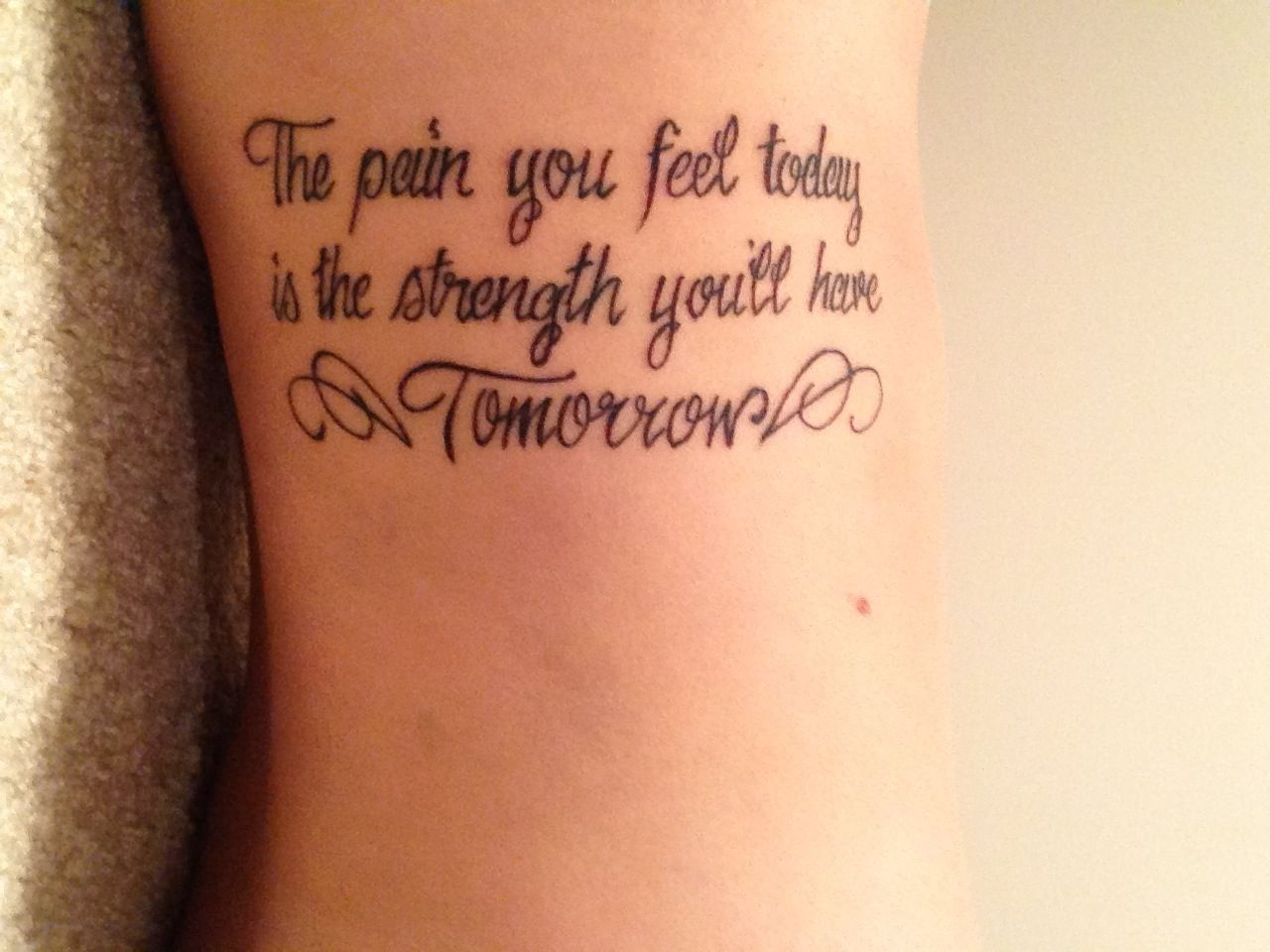 40 meaningful tattoo quotes to get inspired - Strength Tattoo Quotes On Side With Wings The Pain You Feel Taday Is The Strength You Ll Have Tomorrow Want This On Shoulder